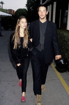 sofia coppola & keanu reeves. She, Ione Skye, and Molly Ringwald got ALL the hot guys ;) damn!