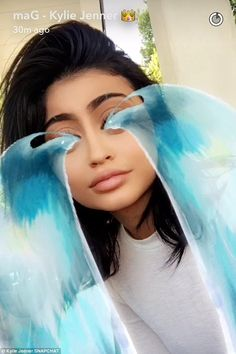 Moved to tears: Kylie, 18, was so overcome by emotion at the cuteness of it all that she used a Snapchat filter to show waves of blue water pouring from her eyes