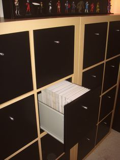 IKEA expedit shelves with drawers. So much cleaner than those ugly white comic short/long boxes