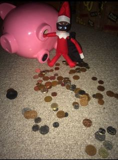 Piggy bank robber elf on shelf