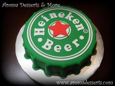 """Heineken Cake 10"""" Orange cake with Dulce de Leche filling, soaked with Special Pampero Oro Venezuelan Rum syrup and covered with..."""