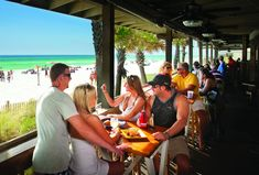 It's easy to get swept away by the picturesque parks, white sand beaches, and glorious views of Panama City Beach , Florida, and its food offerings are just as impressive. From a beachfront doughnut shop to a restaurant where you dine under the twinkling lights of a tree in the center of the dining..