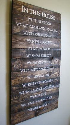 Family Rules sign hand painted on rustic pallet wood.