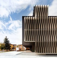This building in Pamplona, Spain, by Vaillo & Irigaray & Galar is characterised by an outer skin that envelopes the facade. The perforated… Building Skin, Building Facade, Building Exterior, Design Exterior, Facade Design, Interior And Exterior, Facade Architecture, Beautiful Architecture, Contemporary Architecture