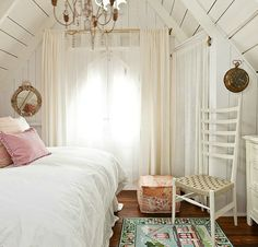 Tiny bedrooms can be so charming and fun to decorate. The wooden walls/ceiling frame it perfectly.