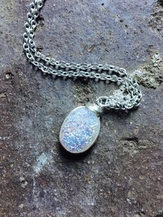 A personal favorite from my Etsy shop https://www.etsy.com/listing/477151108/rainbow-opal-druzy-necklace-silver
