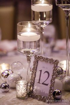 Elegant Winter Wedding is Made of Christmas Magic Elegant Cleveland Winter Wedding. Silver Centerpieces with Christmas Bulbs and floating candles. Silver Centerpieces with Christmas Bulbs and floating candles. Christmas Wedding Centerpieces, Silver Wedding Decorations, Silver Centerpiece, Wedding Table Centerpieces, Wedding Flower Arrangements, Flower Centerpieces, Centerpiece Ideas, Silver Wedding Favors, Floating Candles Wedding
