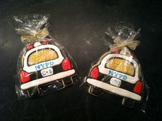 Police car wedding favor cookies (size - large): custom cutter by www.ecrandal.com.  Tips:   - Lettering painted on with airbrush (not gel) food coloring.  - Heart applied with food coloring marker. - Luster powder mixed with vodka applied to tail lights & sirens.