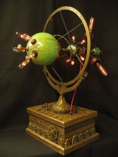 """This is my Steampunk lamp Diabolical Box #125 I call it The Elegant Machine. At 27"""" tall this is my largest Diabolical Box to date. I found this very cool box from India and the holder from an antique world globe."""