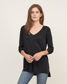 Womens Long Sleeve Tee | A legging-friendly essential with a relaxed v-neck, featuring asymmetrical hem with side slits | Abercrombie.com