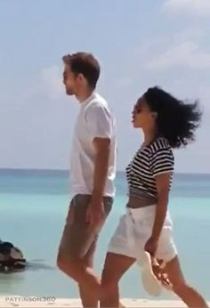 pattinson360: Screenshot from the short video of Rob and Tahliah walking on the beach in the Maldives. 1-9-15