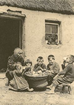 AT THE POT, CIRCA photograph by A. Cutler and shows barefoot children eating potatoes and milk outside a cottage in Ireland with an older woman Antique Photos, Vintage Photographs, Vintage Photos, Old Pictures, Old Photos, Irish Celtic, Gaelic Irish, Irish People, Irish Cottage
