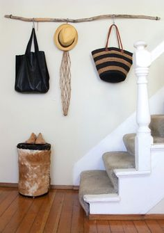 1. ENTRYWAY RACK . Adding these simple hooks to a rustic branch for entryway storage is such a clever idea! This is a perfect example of how versatile these hooks are because they can be mixed and matched with a huge variety of rails. Every home is a bit happier with some hooks by the front door for holding those current hats, coats and bags. via Design Sponge
