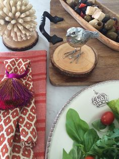 Transitioning into Autumn: El fresco dining with wooden coasters, cast iron handled tray, serving bowls, global inspired linens and whimsical tasseled napkin rings all from HomeGoods welcomes Fall entertaining.