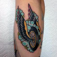 Winged Motorcycle Wheel Tattoo