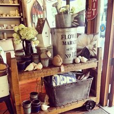 Love these flower pots, vintage watering cans and antique birdhouses. Summer ain't over!