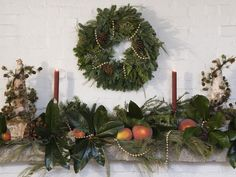Fresh cedar pine and greens with peaches, pinecones and berries were combined for an ultra-natural and festive look. Strands of gold beads add a surprising hint of color within the garland.
