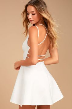 The Believe in Love White Backless Skater Dress will make a romantic out of you! Medium-weight stretch knit shapes a princess-seamed bodice, with a plunging neckline, and strappy, open back. Fitted waist flares into a flirty skater skirt. Hidden back zipper.