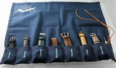 The GWC Ultimate Wristwatch Roll with Weekly Planner project on Kickstarter by Genesee Watch Co.  You can organize your favorite 7 watches by the day of the week.  Also included is an extra slot for a watch tool.  Made out of blue canvas with contrast stitching secured by a leather tie.