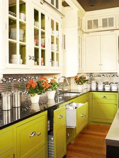 Lovely two tone kitchen:   eggshell upper cabinets & doors with glass…