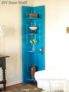 Learn how to turn an old door into a corner door shelf! Great way to reuse an old door and decorate that empty corner. A Great DIY! - Option for old kitchen and basement doors with windows, but remove window portions and create corner tables/shelves. Door Corner Shelves, Corner Door, Corner Unit, Room Corner, Corner Space, Corner Storage, Kitchen Corner, Small Corner, Door Storage