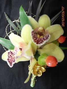Orchid boutonniere for wedding , events and prom.