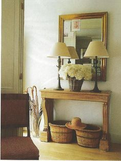 Foyer table, woven basket of peonies, wooden baskets...