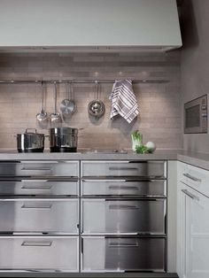 Really amazing beautiful drawers.  Love so much and would look beautiful with wood counters and tile flooring eclectic-kitchen-designs-beauxarts02-siematic-4.jpg