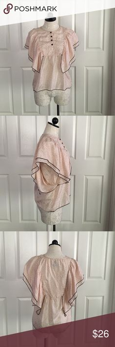 """Chelsea Flower Pink Blouse Cape Sleeves New no tag. Cute and unique style top by Chelsea Flower from Nordstrom. Buttons front at top, lil dark and light pink prints all around, cape style sleeves with black scallop trim. Size small, 100% silk, front length 24"""", across bust 18"""". Chelsea Flower Tops Blouses"""