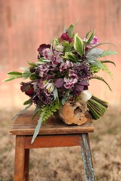 Exquisite Hand Tied Wedding Bouquet Featuring: Burgundy Hellebores, Lilies, Marsala/White Carnations, Cranberry/White Sweet Peas, Several Varieties Of Greenery & Foliage