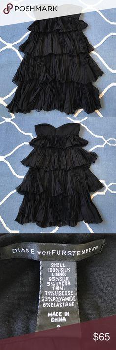Diane von Furstenberg strapless black dress Perfect little black dress. Stretchy strapless top with tiered pleated chiffon skirt. Very flattering on. Diane von Furstenberg Dresses Strapless