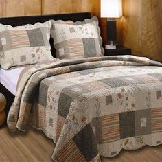 """Add a pop of pattern to your master suite or guest room with this lovely cotton quilt set, showcasing a floral patchwork motif and scalloped trim.    Product:  Twin: 1 Quilt and 1 standard sham Full/Queen: 1 Quilt and 2 standard shams King: 1 Quilt and 2 king shamsConstruction Material: CottonColor: MultiFeatures:  Floral patchwork motifOversized for better mattress coverageScalloped edges with intricate vermicelli quilting Dimensions:   Standard Sham: 20"""" x 26""""   King Sham: 20"""" x 36"""" Twin…"""
