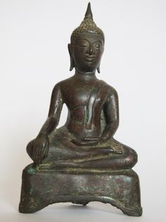 10 G476.4 (M3) A Bronze seated Buddha Thai, Kamphaeng Phet period 15th - 16th century H. 16 cms, 6 ¼ ins Price: £1,800 Note: Restored crack in the midriff area.