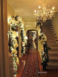 garland with lights on door frame to living room