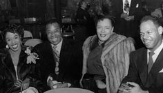 Billie Holiday sits with fellow jazz legends, vocalist Sarah Vaughn, trumpeter Louis Armstrong and friend Howard Dennis in 1950.