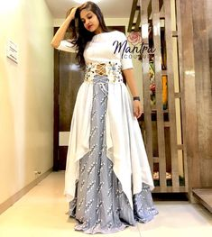 Here are latest Pakistani and Indian long skirts. Choose skirt style from casual or party wear dresses. Watch this video on how to style skirt in different w. Gown Party Wear, Party Wear Indian Dresses, Indian Gowns Dresses, Indian Fashion Dresses, Dress Indian Style, Indian Designer Outfits, Girls Fashion Clothes, Indian Fashion Modern, Party Wear Kurtis