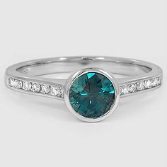 PLATINUM LUXE LUNA DIAMOND RING  Set with 5.5mm Montana Teal Round Sapphire (From Unique Colored Gemstone Gallery)