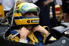 Monza, September 1987: Ayrton Senna in the cockpit of the Lotus 99T ahead of the Italian Grand Prix. He would finish the race second behind the Williams of fellow Brazilian Nelson Piquet. © Schlegelmilch