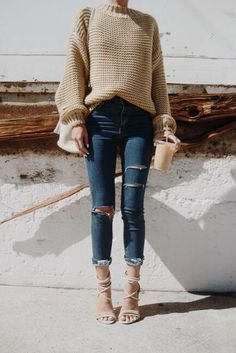 Neutral knit sweater, ripped jeans and heels. Easy, stylish winter outfit