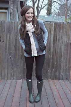 Gray long-sleeved shirt, black vest, black jeans, green hunter boots, and pink pashmina
