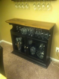 Bar cabinet made from repurposed hutch top turned upside down with recycled barn wood top