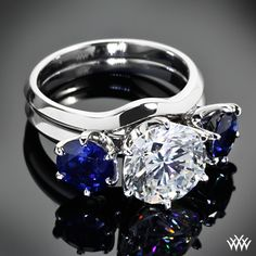 This Custom Platinum Ring Enhancer holds two 6.5mm Blue Sapphires. Adding the ring enhancer to the 6 Prong Solitaire Engagement Rings makes it appear as if it were a three stone ring, rather than two separate rings. If you would like to get a custom quote for this design - Register with Whiteflash and get $75.00 off your first order.   whiteflash.com