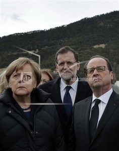 German Chancellor Angela Merkel, left, French President Francois Hollande, right, and Spanish Prime Minister Mariano Rajoy pay respect to victims in front of the mountain where a Germanwings jetliner crashed Tuesday, in Le Vernet, France, Wednesday, March 25, 2015. French investigators cracked open the badly damaged black box of a German jetliner on Wednesday and sealed off the rugged Alpine crash site where 150 people died when their plane on a flight from Barcelona, Spain to Duesseldorf…