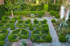 Gorgeous Formal Charleston Garden - Formal Parterre Ben designed the space in the manner of English-patterned gardens. Formal Gardens, Outdoor Gardens, Charleston Gardens, Charleston Sc, Formal Garden Design, Boxwood Garden, Herb Garden, Italian Garden, Garden Architecture