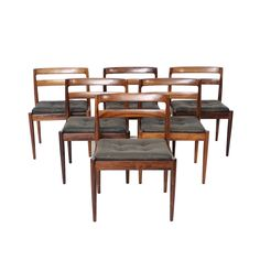 """Vintage Mid Century Modern Set of 6 Rosewood Model """"Universe 301"""" Dining  Chairs Made in Denmark By Kai Kristiansen for Magnus Olesen (marked on bottom of  each chair) 1965 Seats are original black leather tufted cushions that sit on top of frame Design is sleek and classic Chair fr"""