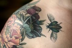 Floral shoulder cap by Alice Kendall with black hellebore, peony, blackberries, and a little beetle. Beautiful tattoos made in Portland, Oregon! Wonderland Tattoo