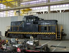 The home is in Gray Rail Shop along with lawn care equipment Railroad History, Rail Car, Rolling Stock, Diesel Locomotive, United States Army, Military Equipment, Diesel Engine, Lawn Care, Heavy Equipment