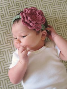 Crochet headband with large flower