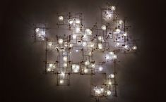 Real Dandelions Surround LED Lights in Unique Chandeliers - My Modern Metropolis