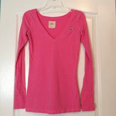 Hollister Pink Long Sleeve Shirt A soft pink long sleeve top quality top by Hollister. In good condition other then a tiny spot seen in photos, not noticeable. Hollister Tops Tees - Long Sleeve